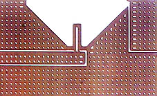 Single-layer magnetometer patterned with holes for noise reduction.